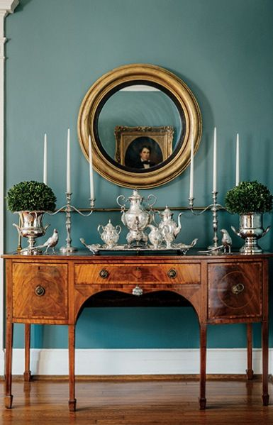 The walls are a very pretty color!! - lovely with the traditional dining room sideboard and accessories.