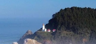 Heceta Head Lighthouse - Florence, Oregon    Some believe a mother who lost her child on the nearby cliffs now haunts that area near Florence, Oregon.  She is known as The Gray Lady of Heceta Head Lighthouse.  Read the full story>>