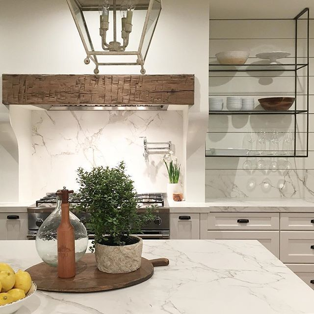 Reclaimed Beam range hood. Pot filler faucet. Recessed stove nook. Bread board on display. Lemons on display.