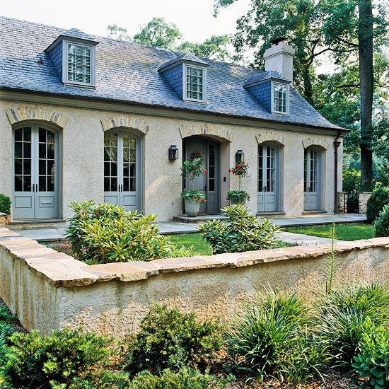 A neighborhood misfit turned old-world charmer, this country French-styled home is now a visual masterpiece! http://www.bhg.com/home-improvement/exteriors/curb-appeal/before-and-after-home-exteriors/?socsrc=bhgpin122314frenchtwisthomeexterior&page=13