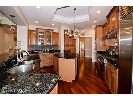 9476 Withers Mill Way, Warrenton, VA 20186 — Custom light-filled home. Privately sited on 13 acres. 3-sided brick construction. 4400 sq ft living space (plus 2200 unfinished). 700 sq ft wrap-around covered deck. 3-car attached garage 700 sq ft.  5 sets of French doors, 48 windows. Exotic wood floors throughout living spaces. Custom maple cabinetry with leaded glass. Top of the line appliances. Custom built-ins. Huge his  hers walk-ins.