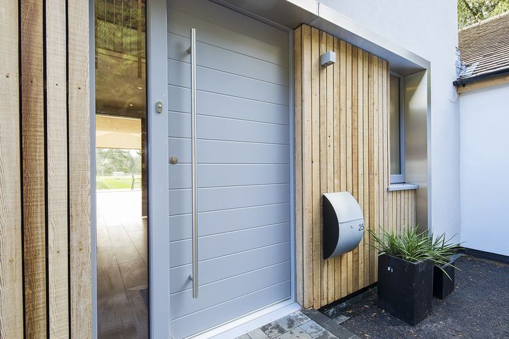 JeTrae Alpha door painted light grey externally and finished in natural light oak inside.