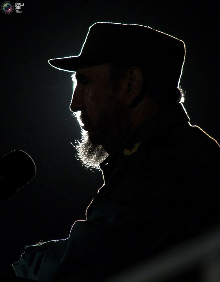 Cuban President Fidel Castro addresses the audience during an event with his Venezuelan counterpart Hugo Chavez on Havana's Revolution Square February 3, 2006. Chavez arrived in Cuba on Friday for a 24-hour visit to accept an international award from UNESCO and open the Havana international book fair honoring Venezuela. Picture taken February 3, 2006 REUTERS/Stringer