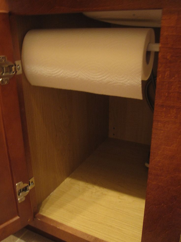 Another great way to use a tension rod - keep paper towels handy under the sink.