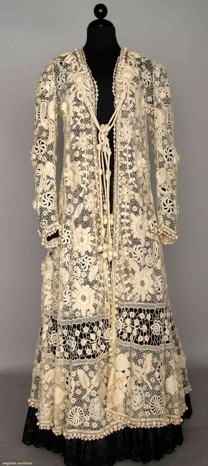 Belle Epoque Irish Lace Coat, C. 1900, White, full length, raised petal blossoms, bnd near hem of openwork Irish lace, soutache trim in F & B yoke area, small crochet balls around perimeter & hem, cord tie w/ crochet strawberries, Augusta Auctions, November 13, 2013 - NYC