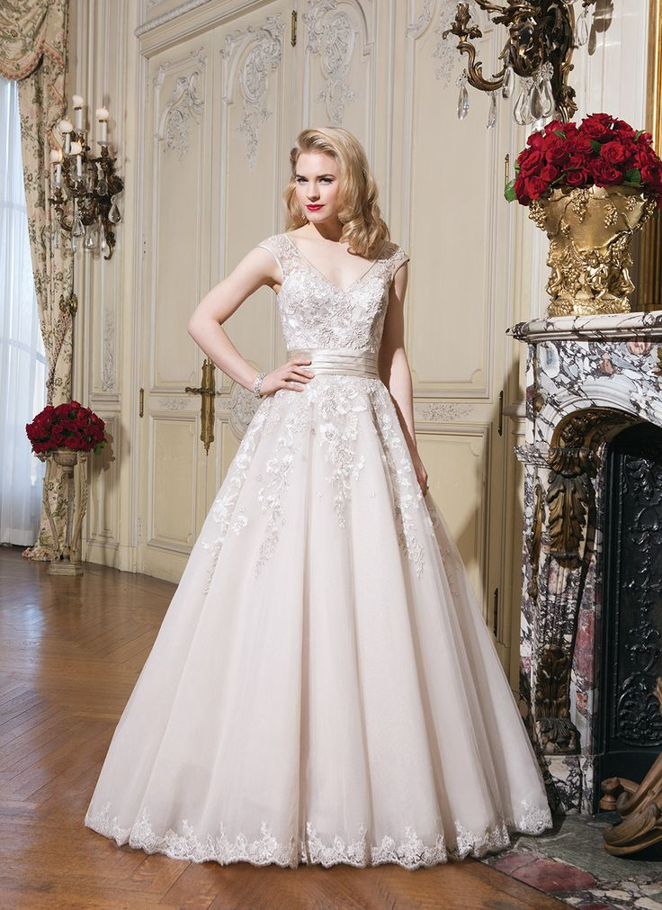 Justin Alexander wedding dresses style 8760 Silk dupion, embroidered lace ball gown wedding dress adorned by a V-neck. With a pop of champagne color.