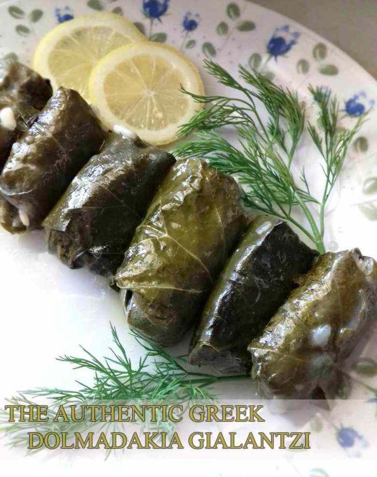 Greek Stuffed Vine Leaves With Rice And Pine Nuts. All slowly cooked in a lemon and olive oil sauce. #vegan #vegetarian #stuffed #vineleaves #Greekfood