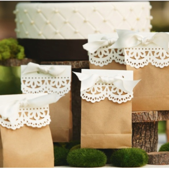 Brown lunch bags with doilies or scallop cut paper...