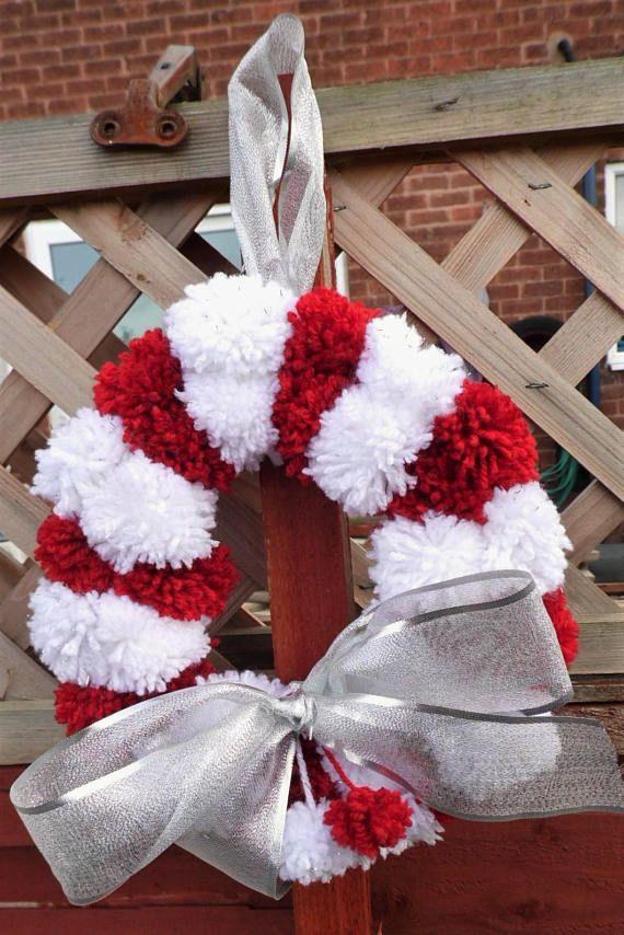 Handmade Christmas Pom pom wreath in candy stripe design