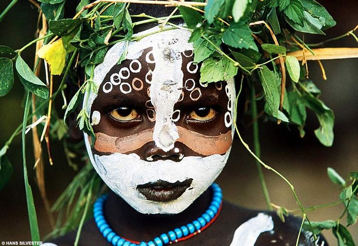 Young Omo boy, from Natural Fashion, Hans Silvester. Stunning photos of the Surma and Mursi tribes (East Africa) , in their natural adornment. You have to see this book!