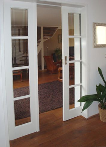 Sliding doors into the walls.