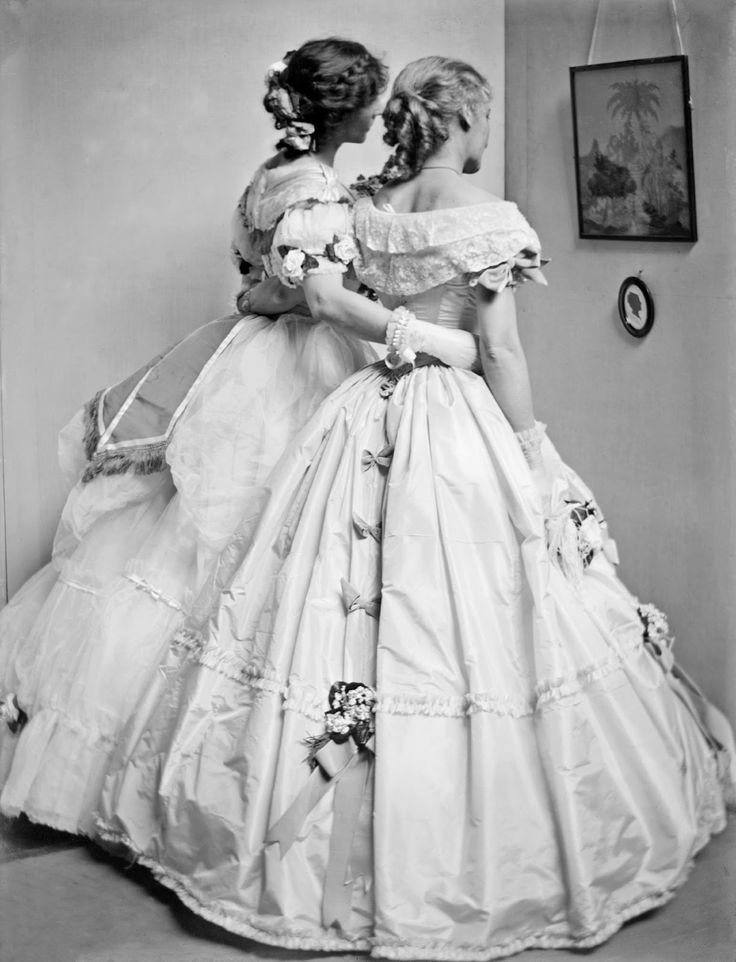 A study posed by the Gerson sisters in their Crinoline Ball costumes, 1906. by Gertrude Käsebier