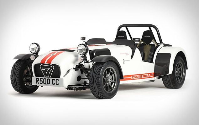 Caterham Superlight R500  open cockpit, six-speed gearbox, carbon dash, nose, front, and rear cycle wings, carbon kevlar seats, four-point harnesses, 13-inch black cast aluminum wheels, a Momo steering wheel, and ventilated disc brakes, all of which combine to trim weight, resulting in a 0-60 time of just 2.88 seconds and a top speed of 150 mph.