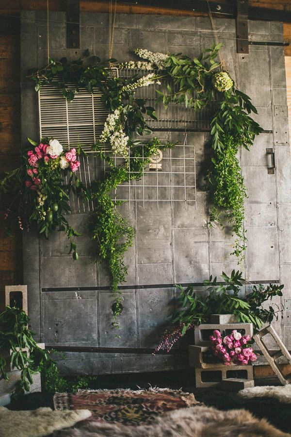 ceremony backdrop  with eclectic panels and floral enhancement