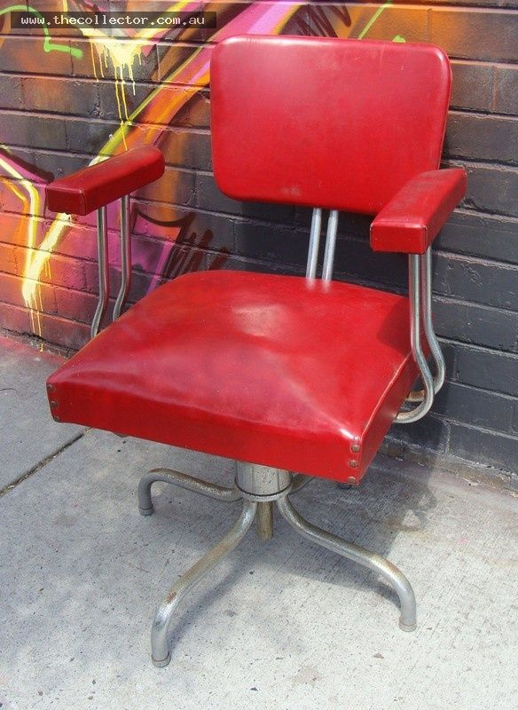 Vintage industrial  REMAC  chrome swivel chair upholstered in red vinyl