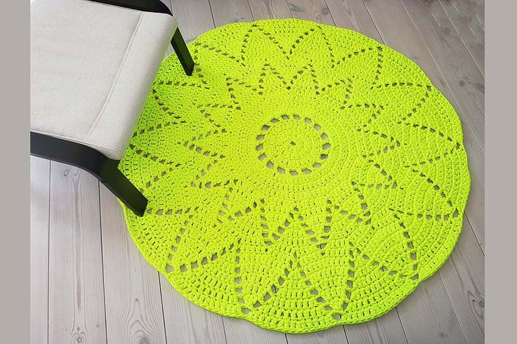 Neon yellow crochet doily rug with a diameter of 137 cm / 54 inches. It is made of thick cotton t-shirt yarn.