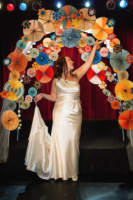 The wedding arch idea - maybe expand this to other decorating ideas - borders, garlands....just need tons of paper fans