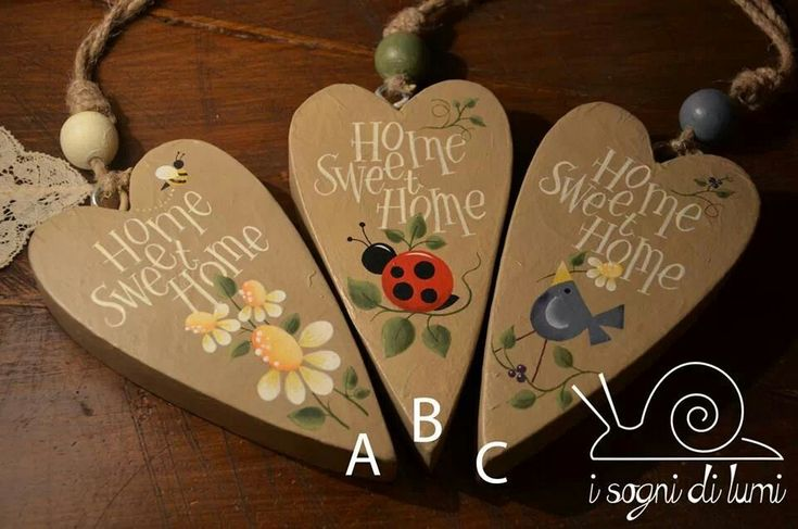 CUTE!    Heart shaped ornaments with painted designs on them