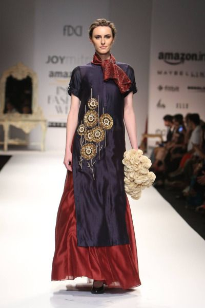 Designer Joy Mitra's collection at Amazon India Fashion Week Autumn/Winter 2016 was an impressive array of dresses displaying Indian spirit and rich colours, like red, green and dark blue. The long glossy dresses were heavily embroidered, making for a distinguished style.  #Amazon#AIFW#2016#Autumn#Winter#Fashion#Models#Indiandesigner#StrandofSilk#amazonfashionweek2016#fashionshow#catwalk#joy mitra#long dresses#red dress#embroidered dresses#embroidery#glossy dress#silk dress