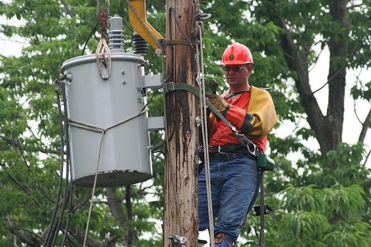 A Niagara Mohawk Power lineman installing a new transformer, replacing one that was fried by lightning.