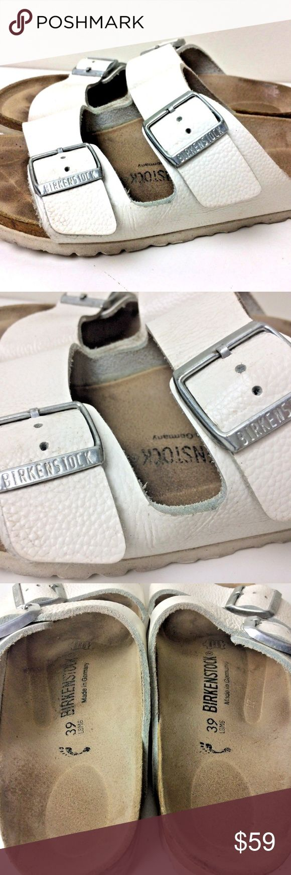 """Birkenstock Arizona White Pebbled Leather Sandals Birkenstock Arizona Sandals  Size 39 F 8 / M 6  White leather uppers with two straps and buckles, contoured cork foot bed includes double jute layer for better-than-barefoot comfort. Raised toe bar, roomy toe box, arch support, and deep heel cup with suede foot bed liner and a rubber outer sole Measurements taken from the outer foot bed heel to toe: 10 1/2"""" widest part of sole: 4"""" pre owned with normal wear,marks,scuffs,scratches to the…"""