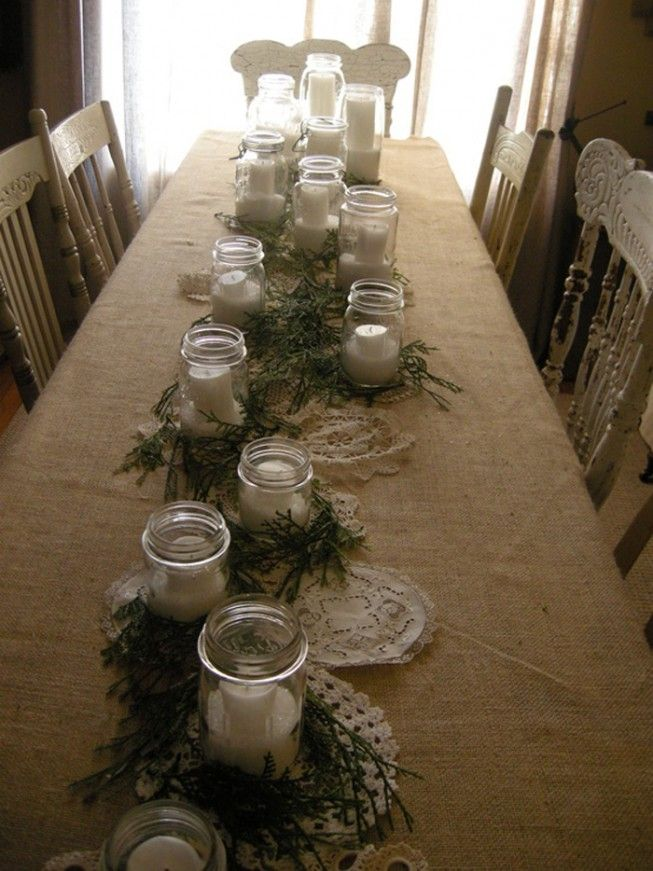 Mason jars and evergreens on burlap table covering 2013 #Christmas Table Roundup Part 2 - Christmas Decorating -