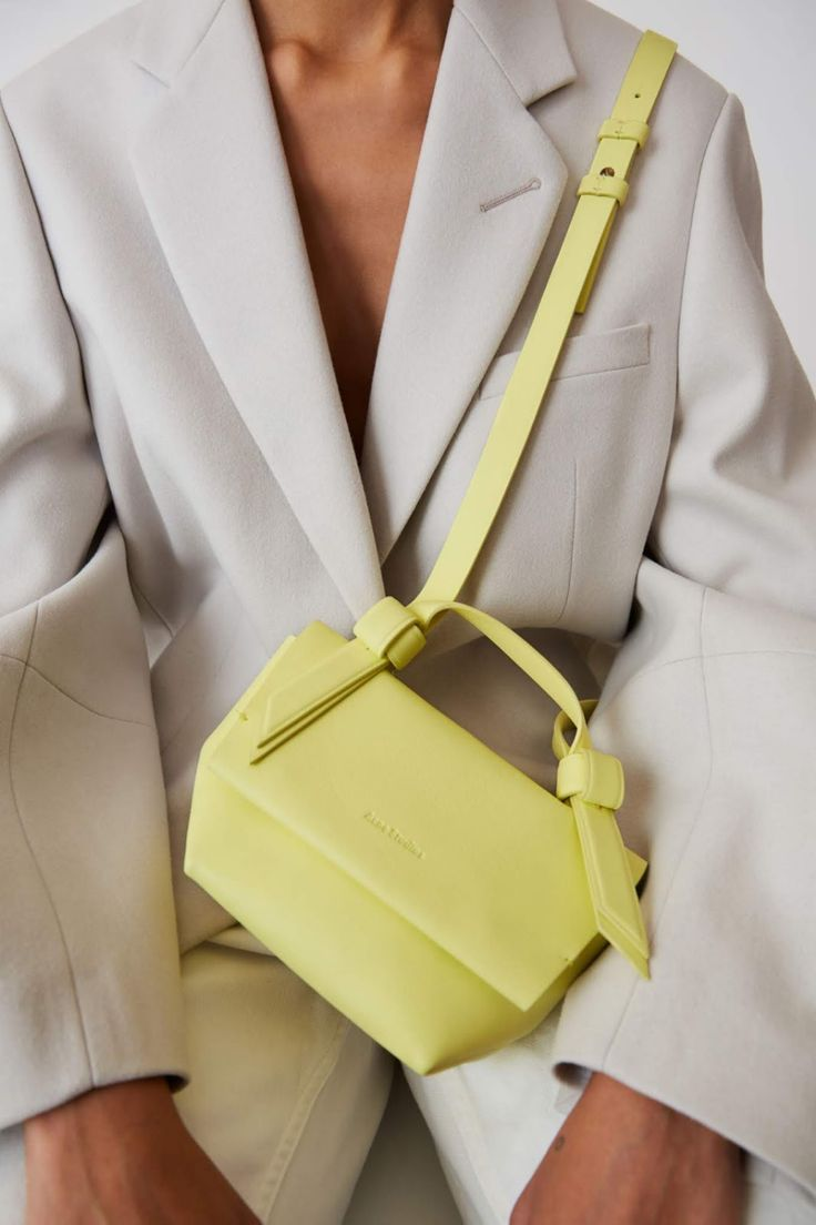 Brighten Up a Neutral Outfit With a Muted Neon Bag