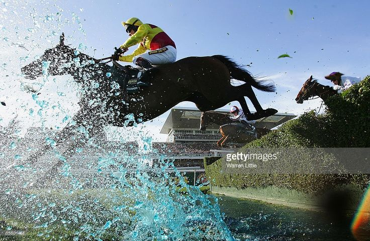 Parson Legacy ridden by Richard Johnson jumps the water jump during the John Smith's Grand National Steeple Chase Handicap at Aintree on April 4, 2009 in Liverpool, England.