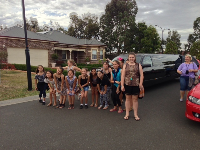 A great group of children enjoying a ride in our limousine for a 10th birthday party - Before the ride