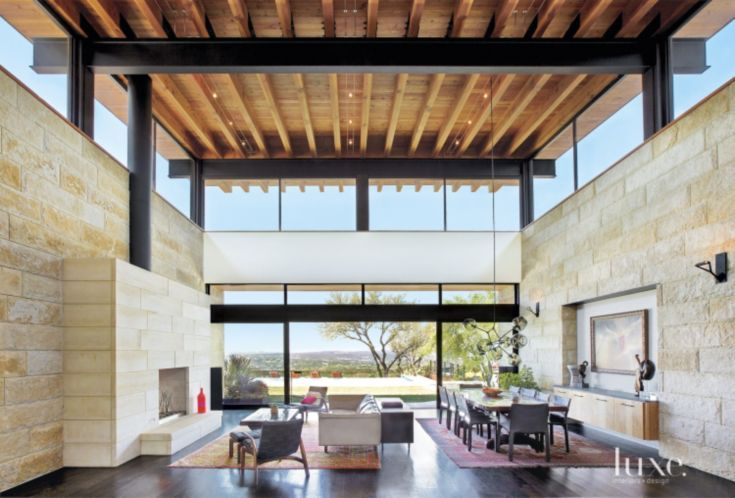 The vast size of this combined living area and dining area and the small amount of furnishings makes for a minimalistic space that allows the focus to be centered on the expansive outdoor views.