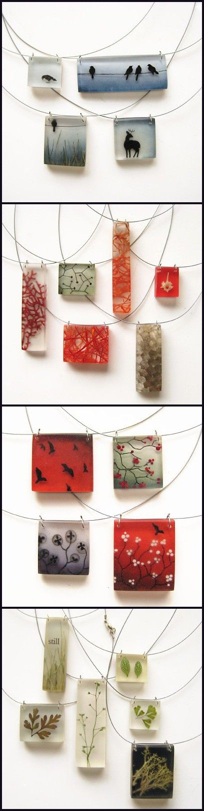 resin pendants. designs could be drawn on shrinky dinks and possibly recreated.