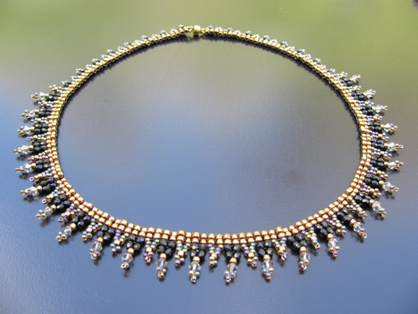 Beautiful necklace, combines Swarovski beads, bronz seed beads & fire polish beads