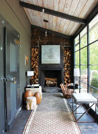 Love this fireplace on the screened in porch! Stacked wood. barn renovation. #barn #screenedinporch #fireplace