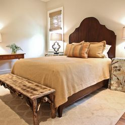 Use the antique folding table at the end of the bed. Build wood top for bench. Kiawah Family Home - transitional - bedroom - charleston - Margaret Donaldson Interiors