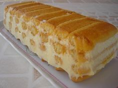 DELICE AU CITRON SANS CUISSON 1 boîte de lait concentré sucré (397 g ) - 4 citrons - une trentaine de biscuits type boudoirs (biscuits à la cuillère pour moi) + ou - selon la grandeur de votre moule - 4 cs de sucre - 150 ml d'eau - 3 cs de Limoncello