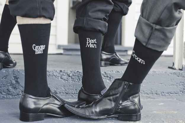 Give the wedding party socks that specify their role.