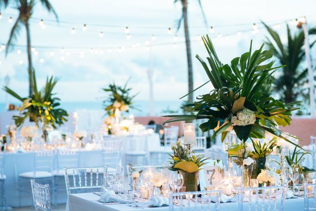 Elegant tropical wedding reception centerpieces. Perfect for a destination wedding by the beach! (Alexander Masters)