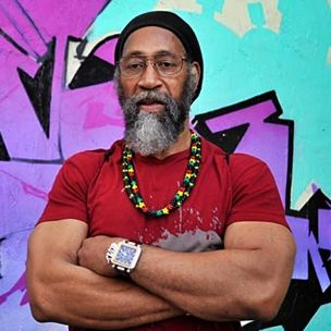 DJ Kool Herc, aka Clive Campbell.  With two turntables and a guitar amp, in the South Bronx at a 1973 party in his building at 1520 Sedgwick Ave, Kool Herc laid the foundation of hip hop music. He invented the now commonplace DJing technique of breaks, or breakbeats. It may not be rock, but you have to give props to a living man who invented an entire genre of music.