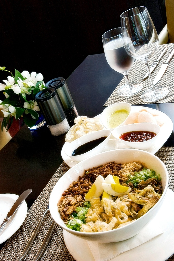"""The Famous """" Bubur Ayam HI"""" Our signature chicken porridge that has been a favorite since 1960's. This is one of my favorite Indonesian Culinary..It tastes thousands flavor..I mean it."""