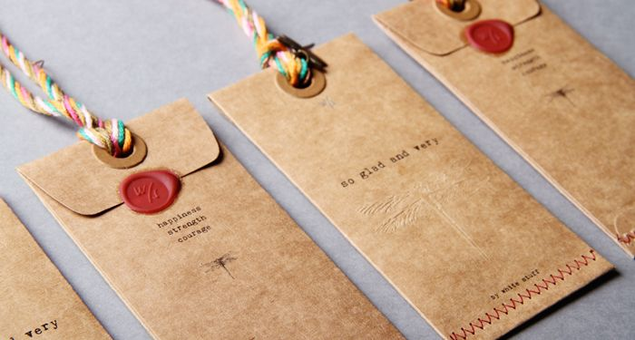 I love the idea of *sewing* together a handmade envelope rather than gluing.