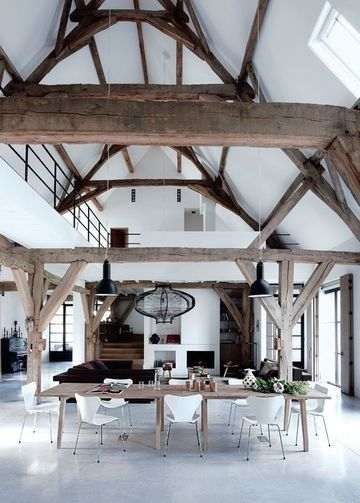 soaring, white ceilings with rustic beams
