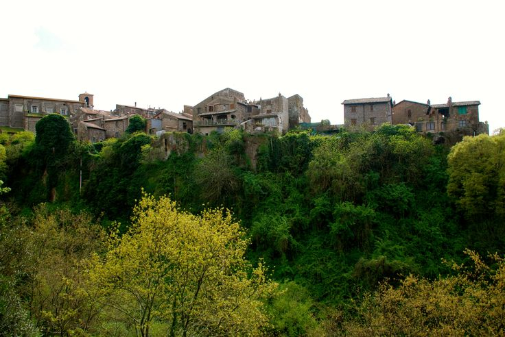 Barbarano Romano is a beautiful Italian Borgo with houses on the edge of a tuff cliff, almost as if they're falling off.
