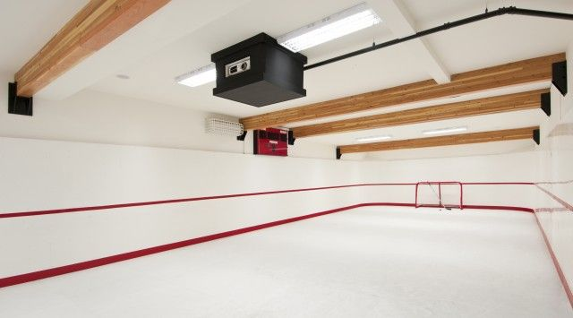 Indoor Hockey Rink. Bear Mountain Custom Home. When a hockey-loving Langford family has the urge to play, they just head to their in-home 56-foot-by-24-foot synthetic ice rink.  They can go downstairs with a full locker-room and tv screen so they don't miss their shows while they play hockey.