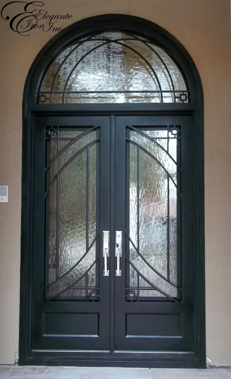 Custom wrought iron door with arched transom double for Front door arch design