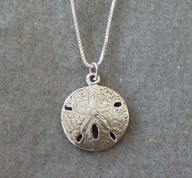 Sand Dollar pendant by dandelion jewelry