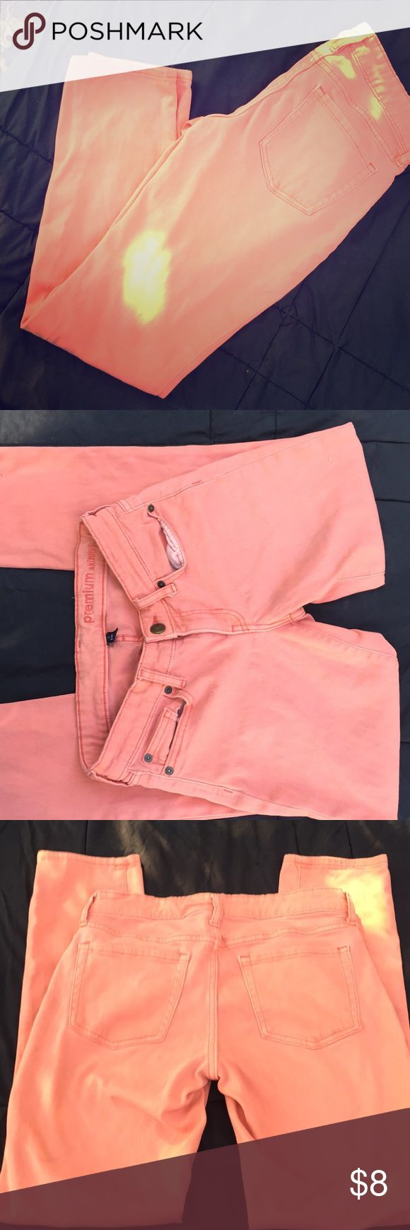 Coral skinny jeans by Gap Used pale orange-coral colored jeans. Size 4.  Room pics outside  the bright spot is the sun GAP Jeans Skinny