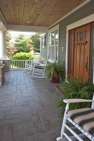 Craftsman Porch with Wrap around porch, Glass panel door, exterior tile floors, exterior stone floors