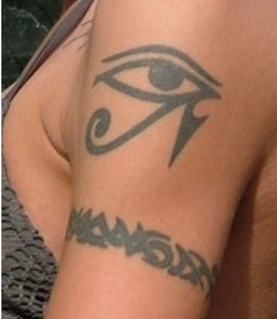 Black egyptian eye tattoo on shoulder