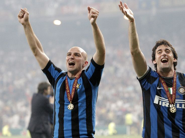 Esteban Cambiasso and Diego Milito, 22 May 2010. Cuchu wears Giacinto Facchetti's jersey after Inter wins Champions League final, 2-0.