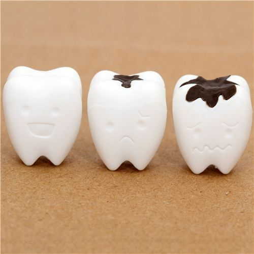 """white teeth eraser from Japan by Iwako by Iwako. $1.39. by Iwako. with happy, sad and unhappy tooth with caries. erasers can be put on pencils. kawaii eraser from Japan. collection: """"Teeth"""". cute Japanese eraser"""